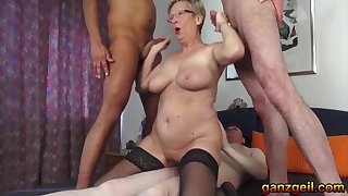 Threesome at hand lustful German Granny