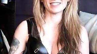 Erotic blooper in latex toying her slaves cunt