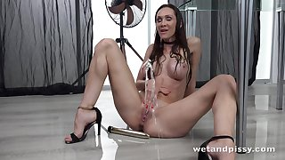 Sexy bitch is pissing in consequence whereof and masturbating pussy